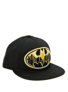 45ca0eb8aac3c Black snapback ball cap with a yellow and white embroidered Batman  cityscape logo.