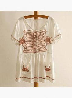 White blouse with brown embroidery