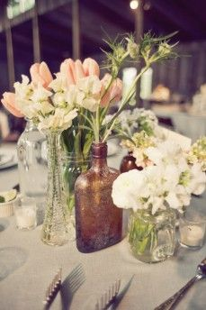 Flowers in old mismatched bottles. (My collection has already begun!) #PerfectWedding