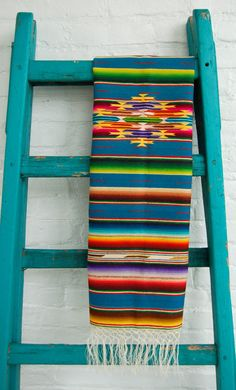 A pretty antique Saltillo weaving beautifully displayed on this turquoise ladder. <3 I love how this weave is displayed on an object that compliments it through colour and the linear quality.