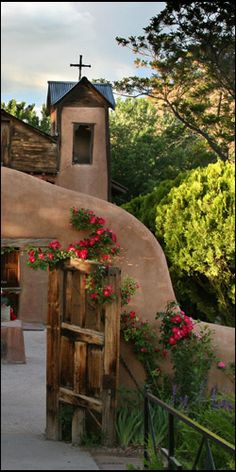 """National Historic Site, Sanctuario de Chimayo. is a holy Catholic church. A small room called contains a round pit, the source of """"holy dirt"""" (tierra bendita) that is believed to have healing powers. testimonials of those purportedly healed.[10][11]"""