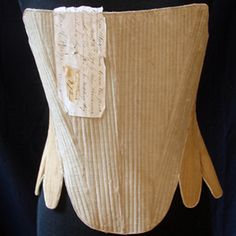"""Rare Early American Linen Corset w/ Provenance  Circa 1700's, a rare early American linen corset with provenance. The note attached reads, """"..."""