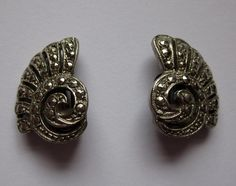 Sea Shell Clip On Earrings, £6.00 by JessamyElvira:  A marcasite shell like clip on pair of earrings. Most likely 50's. Elegant in their simplicity. Perfect for any occasion.     Please note: we are uncertain what metal these earrings are made from.   The earrings are 1.9cm long and 1.5cm wide.   FREE POSTAGE AND PACKING!