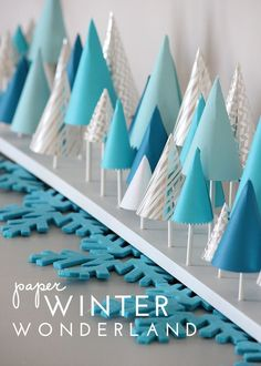 Looking to make your mantel extra festive this holiday season? Try this easy to make DIY Winter Wonderland Decor made from paper! Diy Christmas Paper Decorations, Winter Party Decorations, Paper Christmas Trees, Christmas Party Themes For Adults, Winter Wonderland Centerpieces, Winter Party Themes, Winter Parties, Winter Theme, Winter Holidays