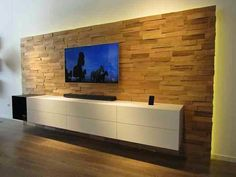 Simple white TV sideboard wall mounted on stone wall
