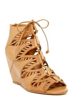 Shady Wedge Bootie by Dolce Vita. Goes up to a size 13 but runs small, have to go up a size. Too bad they didn't go up to a 14!