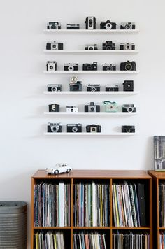 Cool camera collection display /// 5 Clever Home Decorating Ideas (Bottle Display Wood)