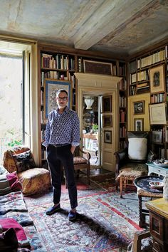 Stephan Janson, Milan's unyieldingly private couturier, in the living room of his apartment wearing a shirt of his own design.