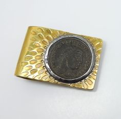This is a handsome gentleman's money clip from the American studio jeweler William Tripp. The clip is superbly crafted in hand hammered brass with sterling silver accents. The clip features an ancient Roman coin, depicting Galerius Maximianus, surrounded by a richly textured surface. | eBay!