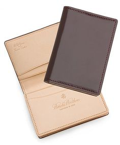 Brooks Brothers already has nice leather business card cases. So I think all we have to do is use those cases + put our logos on there. Cordovan Card Case Cordovan