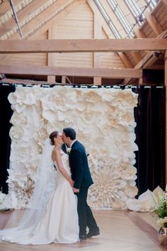 Paper Flower Ceremony Backdrop | photography by http://kristinlavoiephotography.com/