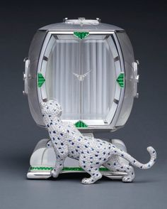 ASPREY 'THE ART-DECO INSPIRED PANTHER MYSTERY CLOCK'  A SUPERB WHITE GOLD, DIAMOND, SAPPHIRE, GREEN TOURMALINE, WHITE AND BLACK MOTHER-OF-PEARL AND ROCK CRYSTAL PANTHER MYSTERY CLOCK CIRCA 1985