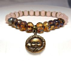 Boho bracelet features a pretty Bronze Sun Charm surrounded by Rustic Czech Glass and Peach Rondelles. Great color combination. *** When selecting a size please note that it is based on actual wrist s