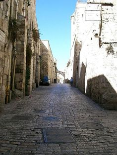 """Via Dolorosa (""""Way of Grief"""" in Latin) is a road in the old city of Jerusalem, a path where Jesus was lead in agony, carrying the crucifixion cross.  There are a total of 14 stations along this path, based on events that occurred on the way to the Golgotha hill, the site of crucifixion, which is located at the Church of the Holy Sepulcher. Eight stations are marked along the old city road, while 6 additional stations are places in the compound of the church."""