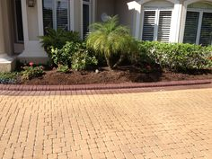 Driveway flatwork addition with Decorative Curbing for the landscape border. Future plans to strip the driveway / paver paint. Apply a tinted concrete stain and sealer to all surfaces.