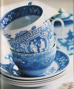 Pretty mismatched blue teacups from the book A Passion for Blue and White by Carolyne Roehm.