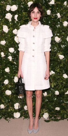 Alexa Chung arrived at the Museum of Modern Art 2013 Film Benefit: A Tribute to Tilda Swinton in a white tweed Chanel dress and grey pointy-toe pumps. A poppy red lip finished the look.