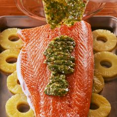 Baked Pineapple Salmon Giving the salmon a quick broil at the end of cooking gives the marinade a chance to caramelizeits too good Just make sure to keep a close eye on i. Salmon Dishes, Fish Dishes, Seafood Dishes, Seafood Recipes, Dinner Recipes, Cooking Recipes, Healthy Recipes, Salmon Food, Pesto Salmon
