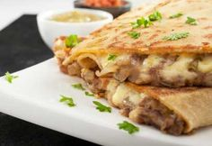 THIS LOOKS DELICIOUS! This bean and cheese quesadilla recipe is a great meal when you are in a hurry. Bean and Cheese Quesadilla Recipe from Grandmothers Kitchen. Mexican Dishes, Mexican Food Recipes, Vegetarian Recipes, Cooking Recipes, Vegetarian Dinners, Cheese Recipes, Healthy Meals, Cheese Quesadilla Recipe, Quesadilla Recipes