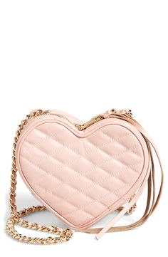 This pink quilted heart shaped crossbody is so pretty.