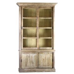 This stunning cabinet features a glass door with a sliding door storage space underneath. The cabinet features a natural finish with white wash.  Measurements: Length: 52 Depth: 20 Height: 94 Return Policy: This item is not eligible for returns or exchanges so please make sure to look over the pictures and ask questions before purchasing this beautiful piece. The applied wax allows the table to age naturally over time. Coasters, place mats, and tablecloths must ...