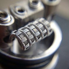Build from @moxiecrimefighter06 for the #LGoldBuildoff entry.  Specs: 8x .5mm KA1 ribbon parallel with 24g N80 wrapped with 36g N60 5 wrap - 3mm  #coilarchitects #l4l #coilporn #wireporn #vape #vaping #vapecommunity #vapelyfe #vapelife #coilbuilding #coilbuilder #coilsmith #coilbuilds #vapebuilds #coilporn #coilart #wireart #wireporn #vapershouts