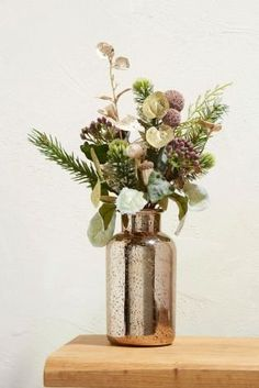 Faux flowers don't have to be dull - keep your home alive with the addition of our golden wilderness mix in gorgeous autumnal shades! Display in a metallic vase to make an extra statement.
