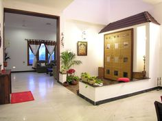 Slope roof and low height wall designed in the puja room gives a traditional look in this courtyard.