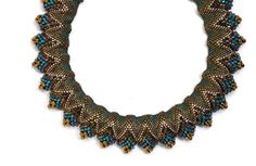 """Flat Cellini pattern, peyote stitch, size 11 to 6 seed beads. Tutorial available through beadandbutton.com, title """"Surfin' the Waves""""."""