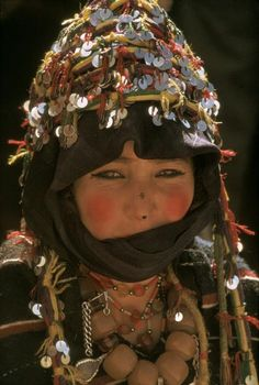 Africa | Morocco. Imilchil. Young bride of Ait Haddidou tribe wearing a cloak of Berber design covered in silver ornaments. 1972. | © Bruno Barbey.