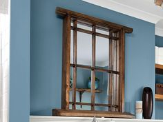 Inject some architectural character into the space above your sink with a window-style mirror.Similar to shown: Reclaimed PalletWorks hanging mirror with sill, about $75; Etsy