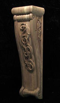 Carved corbel in walnut