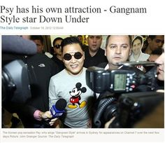 Psy gets swarmed by fans and press upon landing in Sydney, Australia