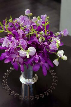 Purple mokara orchids centerpiece #radiantorchidflowers #magentaflowers #purple