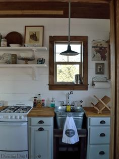 Our little cabin is 384 square feet in total, and includes a bedroom/living area with closet, little 'dining' area, small kitchen with p. Small Cabin Kitchens, Cottage Kitchens, Kitchen Small, Kitchen Tips, Tiny House Cabin, Cabin Homes, Mini Chalet, Little Cabin, Apartment Kitchen