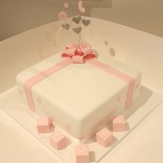 A square white iced cake features iced pink ribbons, scattered cirles and hearts… Square Birthday Cake, Birthday Cake Girls, Christening Cakes, Girl Christening, Baby Shower Niño, Baby Shower Cakes, White Iced Cake, Bingo Cake, Girl Cakes