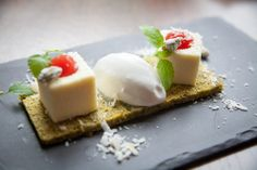 The Pannacotta ($8) at Weslodge Saloon is artfully plated with a base of pistachio, framing two coconut-dusted pannacotta cubes. Located at 478 King Street West.