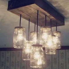 """I call this 8 light mason jar chandelier """" The Betty"""" she is classically beautiful just like her name. She is considered our base model chandelier but is far from ordinary, rustic reclaimed wooden canopy 8 pendant lights at 24"""" stagger this light would be the perfect addiotion to anyone's kitchen or dinning room!Please visit our website here for more items: If you have any questions about this product and how you can customize it.Details:Welcome to Rubbish love shoppe!, th..."""