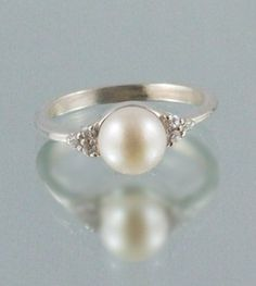 Surprisingly I really love this...classic pearl ring