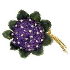 A Retro Carved Amethyst and Jadeite Flower Brooch, the cluster of Amethyst blossoms accented with rose Diamonds and framed by Jadeite leaves, in Gold with engraved ribbon motif around the stems. Purple Jewelry, Amethyst Jewelry, Flower Jewelry, Crystal Jewelry, Silver Jewelry, Diamond Brooch, Diamond Gemstone, Diamond Rings, Art Deco Jewelry