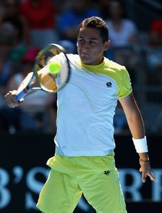 Nicolas Almagro of Spain plays a backhand in his fourth round match against Janko Tipsarevic of Serbia during day seven of the 2013 Australian Open at Melbourne Park on January 20, 2013 in Melbourne, Australia.