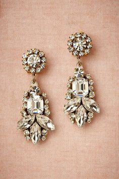 Wearing your hair in an up-do with dangly earrings would add some extra bling, too.