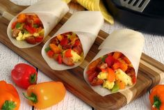 Paleo Breakfast Burritos made with Paleo Wraps. Hot skillet breakfast hash all wrapped up and ready to go. Gluten-free & 100% paleo