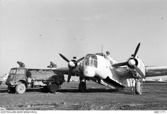 Foggia, Italy. c. January 1944. Maintenance personnel refuelling a Vickers Wellington aircraft of No. 458 Squadron RAAF.