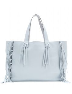 Valentino - C-Rockee leather tote - Valentino's 'C-Rockee' tote is constructed from soft, grainy powder-blue leather. Unlined and finished with fringed tassels, this roomy piece boasts a bohemian aesthetic that'll bring an instant hit of chic to your look - @ www.mytheresa.com