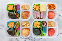 Three have half and avocado with a little bottle of soy sauce.  We like to fill the avocado with soy sauce and eat it with a spoon.  They also have cheese, sugar snap peas, apples, and crackers.  One doesn't like avocado or those kind of crackers, so she got ham, cottage cheese, and a mixture of bunny crackers.  Sauce is in these bottles .