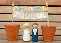 MR & MRS BUNTING for your Custom Wooden Bride and Groom Wedding Couple Cake Topper. £15.00, via Etsy.