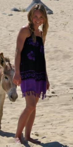 Amber at a beach with a donkey Maybe from a trip to mexico