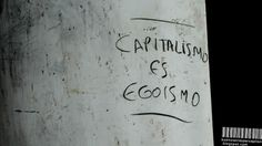 Capitalismo es Egoismo (Capitalism is Egoism) Written on an Advertising Light Box in the City Center of Buenos Aires, Argentina
