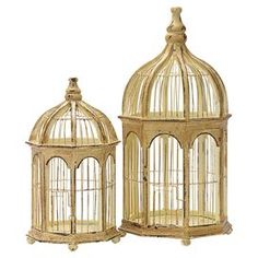 "Two gazebo-style birdcages with distressed finishes and wrought iron bars. Product: Small and large birdcageConstruction Material: Aged pine and wrought ironColor: GoldDimensions:  Small: 15.5"" H x 7.75"" Diameter Large: 21.25"" H x 10.25"" Diameter"